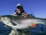 Burton Rogers with a rockfish that defies the predictions of scientists for the 2010 season.