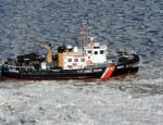 Coast Guard Cutter Capstan clears a path through ice on the Chesapeake Bay.  Coast Guard photo