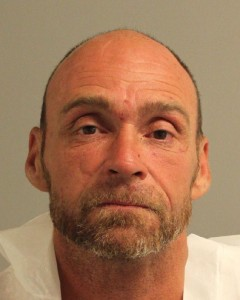 Joseph Eugene Wright, charged with murder at hobo camp