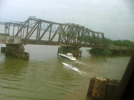 This view of a pleasure boat passing under the railroad bridge crossing the Potomac from Virginia to the District of Columbia was taken from a Metro train.  THE CHESAPEAKE TODAY photo