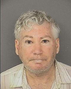 David Lee Garrison, charged with possession of alcohol at bus stop near homeless shelter