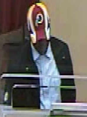 Given the high salaries paid to Redskins players, this bank robber is likely just a fan, perhaps getting together the money he needs to pay for his season tickets.
