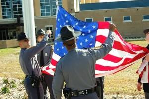Virginia State Police raise the U. S. flag.