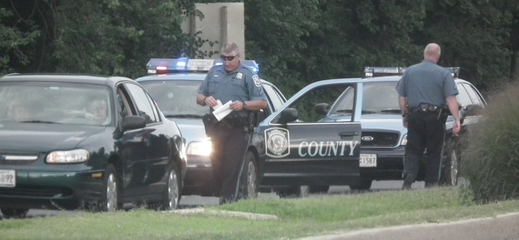 Motorist recieves written document from Anne Arundel County Police Officer.  THE CHESAPEAKE TODAY  photo