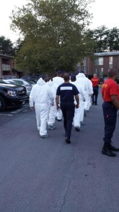 PG Police bring out academy class to search for body parts. Photo PG Police.