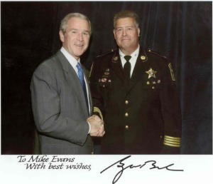 Calvert Sheriff Mike Evans with President George W. Bush at Calvert Cliffs. The security for the plant was likely higher the day President Bush visited...maybe. Photo courtesy of Sheriff Evan's election website and the taxpayers.