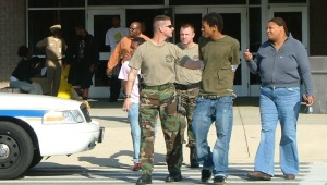 This punk is being hauled out from Great Mills High School following a fight involving more than a dozen students. While the uproar ensued, most other students went about their daily routines.  THE CHESAPEAKE TODAY photo