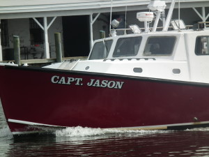 The Capt. Jason heads into Crisfield harbor which now is the center of criminal activity of commercial watermen raiding oyster sanctuaries.  THE CHESAPEAKE TODAY photo