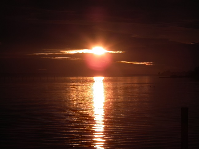 The sun slips into the night leaving a large image in the shape of a cross over St. Clements Island in the Potomac River. This was the site of the first Catholic Mass in the English speaking colonies. The Mass was said by Father Andrew White on March 25, 1634.  THE CHESAPEAKE TODAY photo