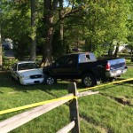 Crazed motorist's pickup smashed deputy's car and pushed it down hill