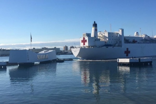 USS Arizona memorial struck by USHS Mercy being moved by tugs. Photo by unidentified Navy sailor
