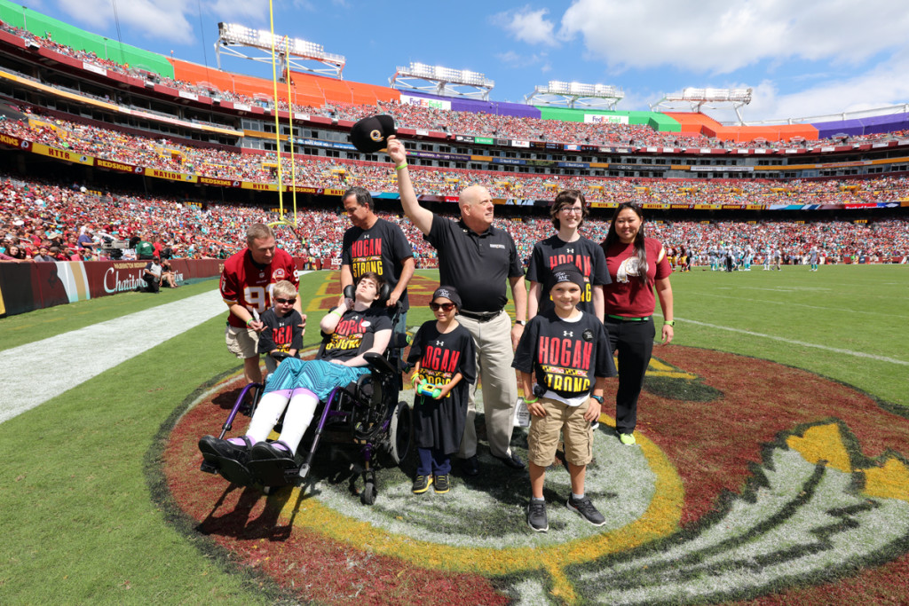 Maryland Governor Larry Hogan and kids for Cancer Awareness for Children Day at Redskins home opener loss to Miami (17-10) on Sept 13 2015