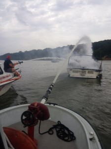 Fighting fire on the river. Goodtime girl was burned almost the waterline, then sunk.   Susquehanna Hose Co. photo
