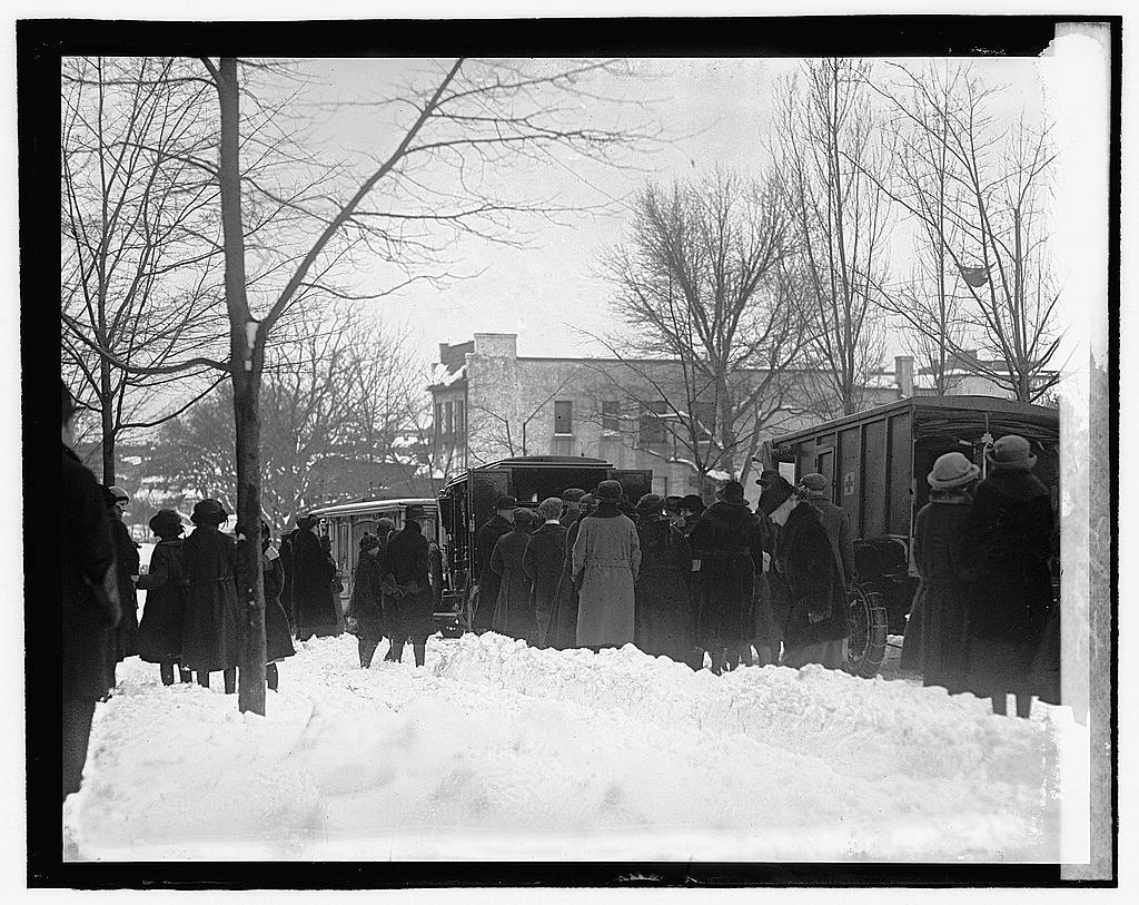 Crowds gather to learn the names of the dead at the ...