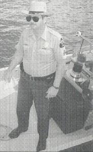 Cpl. Dennis Leland on Natural Resources Police boat