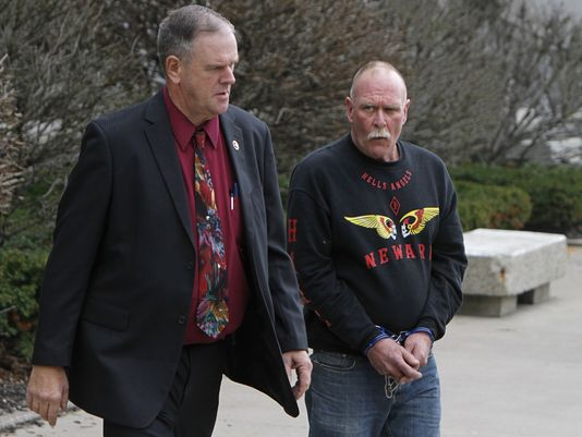Hells Angels Member Robert Moran being escorted from Federal Court in Rochester NY in April 2011 photo Democrat & Chronicle