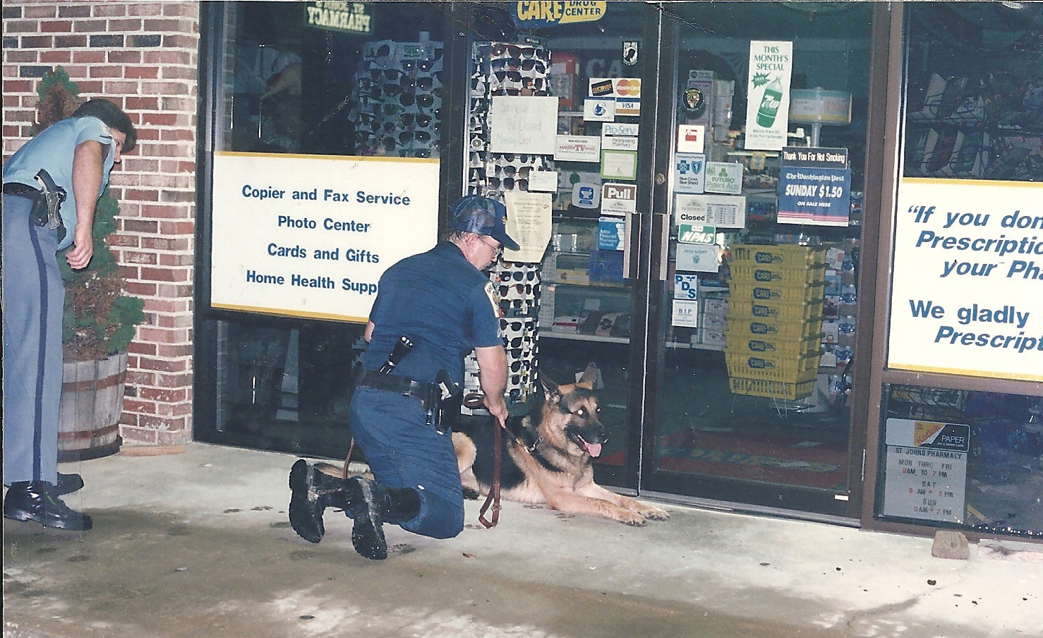 St. Mary's Sheriff's Deputy Phil Jospeh and DFC William Bell & K-9 Tarras in front of St. Johns Pharmacy after tracking burglar
