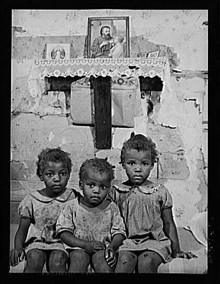 Three of eleven children of Edward Gant, Ridge, Md. This photo was taken in the 1930's.
